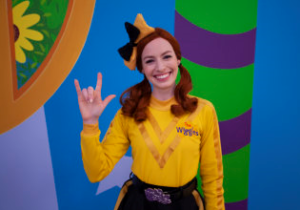 Emma from The Wiggles signs a friendly greeting